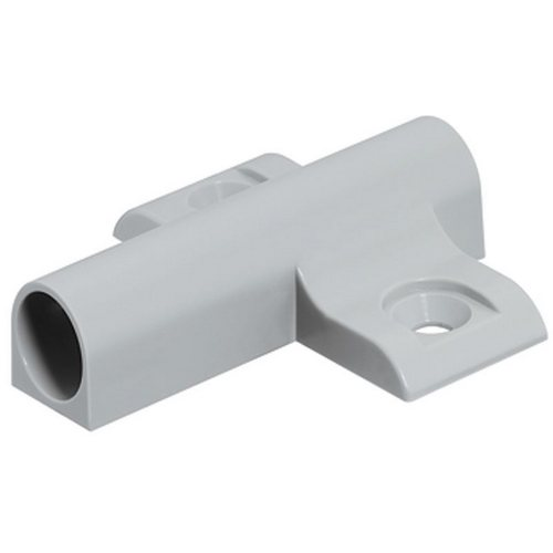 Cruciform adapter housing for 32 mm series drilled holes